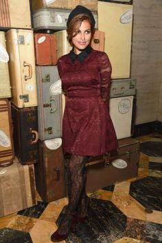 During her most recent Eva Mendes x New York & Company FW 16 Show, Mendes posed in a darling bureaux peter pan styled dress. She completed her looks with black lace stockings and burgundy Mary-Janes.