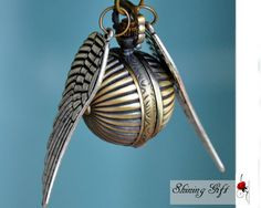 Sale-Enchanted Golden Snitch WATCH necklace sliver Double side wings harry potter-Deathly Hallows. $3.99, via Etsy.