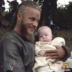 Men holding babies.. Nice. King Ragnar holding a baby... Yes please! LOL