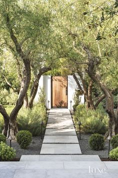 Spanish Colonial White Front Elevation wiith Teak Gate | LuxeSource | Luxe Magazine - The Luxury Home Redefined