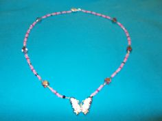 Handmade Pink glass beaded necklace Butterfly pendant by JRATBLING on Etsy