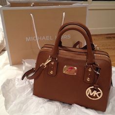 "NEW Michael Kors SM Satchel Saffiano Brown Leather NEW! Michael Kors Small Satchel in Saffiano Luggage Brown Leather Handbag with strap. This beautiful bag is just the right size for everyday use. The interior features four (yes, 4!) sewn pockets, AND a zipper pocket! The best part of this bag is the pocket on the back exterior of the bag. It fits my cell phone perfectly! Talk about convenience; this bag is a winner! 10"" W x 7.5"" H x 6"" D Michael Kors Bags Satchels"