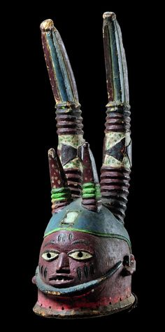 "Africa   Headdress of ""oro"" secret society from the Yoruba people of Nigeria   Wood, polychrome paint, mirror glass, brass tacks"