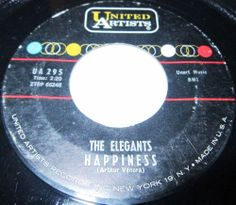 1961 Doo Wop 45 Rpm The Elegants HAPPINESS / SPIRAL On United Artist 295 .. Formed in the mid-50s in Staten Island, New York City, New York, USA, the Elegants were a white doo-wop group. They achieved a US number 1 single, 'Little Star', in 1958, only to disappear from the charts permanently thereafter. The group was comprised of lead vocalist Vito Picone (17 March 1940), Carman Romano (b. 17 August 1939), James Moschella (b. 10 May 1938),