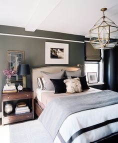 Love the dark rich tones used on the walls with complementing neutrals acessories to make the room cosy for night time, yet bright enough for daytime!