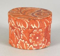 Small round wallpaper box, inscribed on underside Lacy C. Robinson 1830, with an orange foliate decoration on a plum ground, 3'' h., 4 1/4'' dia.