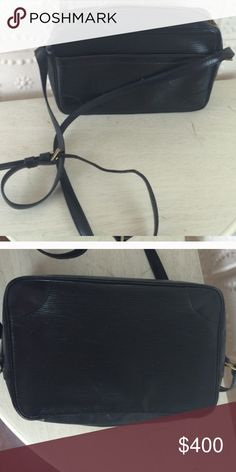 Black Louis Vuitton Cross body bag Authentic Black epi leather Louis Vuitton crossbody bag.   Small marks as expected with a used bag. Inside bag pockets are peeling but are not sticky and still usable.  Additional pics in other listing. Louis Vuitton Bags Crossbody Bags