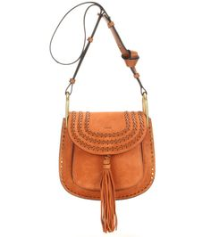 Chloé - Hudson suede shoulder bag - With gold-tone hardware, a terracotta hue and exaggerated stitching, the 'Hudson' shoulder bag from Chloé is a romantic, bohemian dream. With the hanging tassel sealing the deal, note the knot in the strap that adds a casual touch. Wear with a floaty floral skirt for a carefree look. seen @ www.mytheresa.com