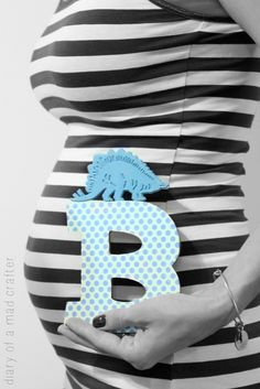 Cute baby maternity with same letter that is in baby's room.