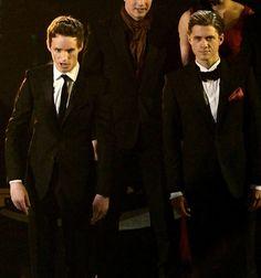 Sooo both are wearing pocket squares. Aaron is wearing red and Eddie is wearing black!