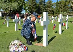 Master CPO of the Navy (MCPON)(AW/NAC) Michael D. Stevens....... Yeoman 2nd Class Kaitlyn Nolan, assigned to the U.S. 6th Fleet flagship USS Mount Whitney LCC 20, places an American flag on the grave of a fallen World War II soldier during a community service project at the Rhone American Cemetery in Draguignan, France. Mount Whitney, homeported in Gaeta, Italy, is in Theoule-sur-Mer, France, to participate in the commemoration of the 70th anniversary of Operation Dragoon......
