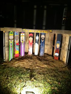 Pallet stable and hand painted nativity we created for Christmas yard decor.