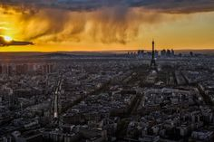 Paris at sunset. Do you see the clouds coming down?It was freaking cold on that roof, but worth it! Paris is burning. Paris Is Burning, France Photography, Photo S, Tower, Clouds, Celestial, Sunset, Places, Travel