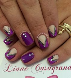 Another beautiful Purple nail art design. The design also incorporates black nail polish to create thin diagonal lines across the purple polish. The beads are wonderful accents added on top.