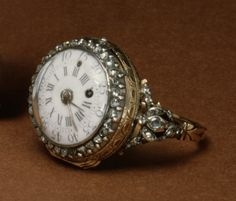 Ring Watch. The white dial is surrounded by a ring of brilliant diamonds. The stones are mounted to form floral sprays on the pierced shoulders of the ring. ca. 1780