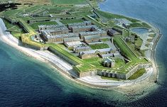Fort George from the West.  Fort George sits behind its massive grass-topped artillery defences on an isolated spit of land jutting west into the Moray Firth at Ardersier, 11 miles north east of Inverness