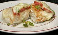 A quick and easy baked halibut recipe with tasty mozzarella cheese and tomato topping. Tasty baked halibut recipe.