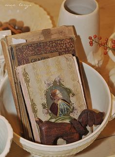 Pretty old books in a white bowl - love the dog, could use my moose instead or perhaps my bear