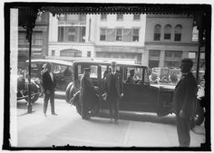 1925   President Calvin Coolidge arrives at the Willard Hotel for Vice President Thomas R. Marshal's funeral.