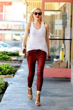 The next step is to play with color. Stefani only needs a white tank top to accent her red, textured denim, making a simple outfit feel anything but.Gwen is wearing L.A.M.B. shoes and Quay Australia sunglasses. For a similar style, try: