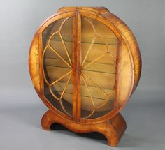 This very stylish Art Deco figured walnut display cabinet is lot 925 in our 31 January Antique & Collectors Auction with an est of £400-500, it's one of many varied lots of furniture in the sale from 17th Century oak to a 1960's teak sideboard all illustrated on our website