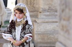 """TRIPOLI, LIBYA - MARCH 13: A Libyan girl wearing traditional clothes attends an event to mark the """"National Day of Traditional Dress"""" at es-Suheda Square in Tripoli, Libya on March 13, 2017. ( Hazem Turkia - Anadolu Agency )"""