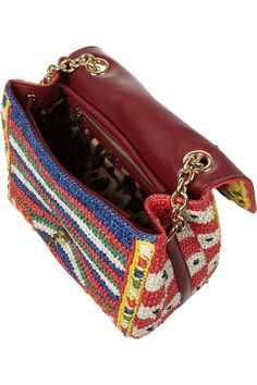 Multicolored woven raffia  Burgundy leather (Lamb) top handle and shoulder strap Bead embellishment, leather base, feet Internal zip-fastening and patch pockets Fully lined in leopard-print satin Turn lock fastening at front