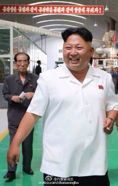 """Guy in back, thinking: """"Sure, Kim Jeong-eun is smiling...but what about the rest of us?"""""""