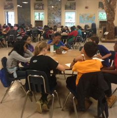 Sixth grade students journaling experiences at the Smith Center.
