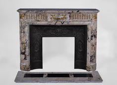 Beautiful antique Louis XVI style fireplace in Breccia marble with fluted rounded corners and gilt bronze ornaments (Reference 2317) - Available at Galerie Marc Maison #antique #fireplace #marcmaison #mantel #french #fleamarket #saintouen #paris #19thcentury #louis16 #style #bronze
