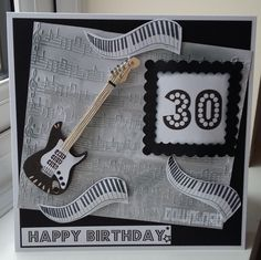 stamped music, embossed notes hand crafted guitar to create this  mans card
