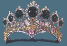 The Seven Emeralds Tiara:  Made in 1958 by Harry Winston of 294 pink, yellow, and colorless diamonds and seven cabochon emeralds set in platinum.  Provenance:  1. Empress Farah Pahlavi of Iran;  for the occasion of her 1958 marriage to Shah Mohammad Reza Pahlavi of Iran.   2. The National Treasury of Iran; ownership of the Iranian Imperial Jewels reverted to the state of Iran after the 1979 revolution and can still be viewed by the public at the Museum of The Treasury of National Iranian…
