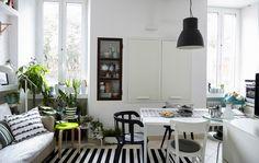 Otimize um espaço pequeno juntando sala e espaço de refeição