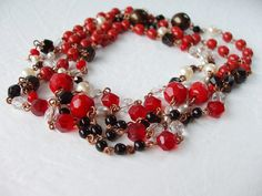 Lovely long necklace with vintage and new glass beads! I combined the hottest red, jet black, pearl and metallic bronze!