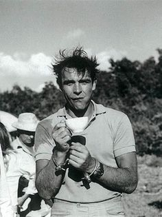Sean Connery as James Bond - drinks his tea while still in handcuffs