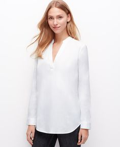 Clean, tailored and sophisticated, our popover silhouette is the perfect canvas to showcase our newest palette of wear-now colors. Split neck with mandarin collar. Long sleeves with button closure. Back yoke with box pleat. Shirttail hem.