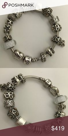 Pandora 925 Silver bracelet with charms Authentic Pandora 925 Sterling Silver bracelet with  charms.  12 silver charms; 2 Silver with 14k Yellow Gold and 2 Silver clips  You can buy separate any charm also.  Comes with box. Pandora Jewelry Bracelets