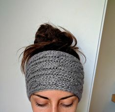 This thick and chunky cable knit ear warmer is a cold weather must. Handmade from itch free, acrylic yarn, youll love how this headband keeps your ears warm and snuggly on chilly morning jogs. Measuring 5.5in wide (14 cm) and 23in around (58 cm), this headband has plenty of stretch to fit most head sizes and hold its shape. Available in several chic colors and shown here in Grey. Dont see the color option youd like? Request a custom order!   Machine wash cold, Reshape and lay flat to dry.