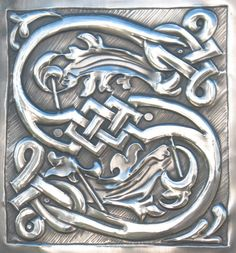 Letter S handcrafted in pewter monogram.. £80.00, via Etsy.