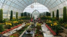 Sunken Garden at the Marjorie McNeely Conservatory, Como Park Zoo and Conservatory, Saint Paul, Ramsey county, Minnesota, USA. It's located at 1225 Estabrook Dr. @ Aida Pl. The conservatory regularly changes the plants so if you visit you might not see the same plants that is shown in this picture…