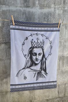 An extra large damask cloth produced on a special Jacquard loom whereby the image of Holy Mary is woven into the fabric.  Manufactured in South Africa on a Jacquard loom Made from 100% cotton Size: 65cm x 85cm Designed by and exclusive to Masquerade