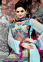 Dreamy variation on shape and forms compliment your style with tradition. The dazzling sky blue georgette churidar suit have amazing embroidery patch work is done with resham, zari and stone work. All over embroidery work on kameez is stunning. The entire ensemble makes an excellent wear. Matching santoon churidar and magenta chiffon dupatta is available with this suit. Slight Color variations are possible due to differing screen and photograph resolutions.