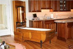 Antique Folding Tub...;very cool.  Hope they were not planning on leaving it in the kitchen...LOL