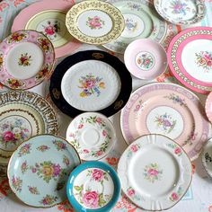 I love the idea of mismatched vintage place settings for a wedding.