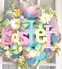 Deco Mesh Easter sign wreath with eggs by Souther Charm Wreaths.