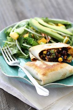 vegetarian black bean burritos...these were so good, fast and easy.  I added lots more cilantro, left out the zucchini and added in more corn in place of it.  Perfect for our meatless meal this week!