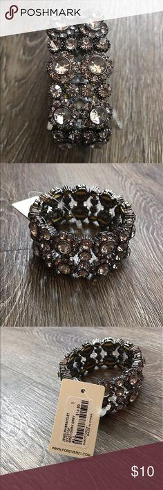 Forever21 Silver Grey Jeweled Bracelet Gorgeous silver/grey jeweled bracelet from Forever21. Brand new w/ tags. One size (stretch). Forever 21 Jewelry Bracelets