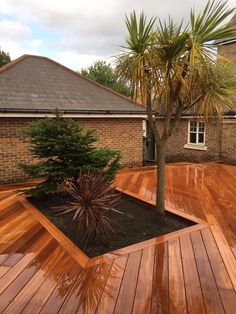 At London Decking Company we create beautiful timber and composite decking areas throughout the London,UK, using the best materials and experienced staff. Hardwood Decking, Decking Area, Composite Decking, Building A Deck, Surrey, Sidewalk, London, Plants, Beautiful