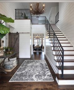 happily // ✧love the white shiplap,black metal railing,stairs, barn door and chandelier!