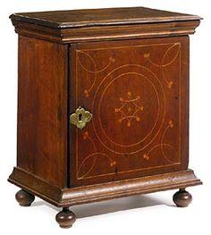 "Inlaid walnut spice box, probably Chester County, Pennsylvania, circa 1730, replaced feet, 19"" x 16"" x 11"""